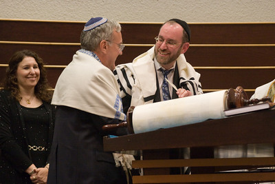 Larry Sidman assists Sofer Rabbi Menachem Youlus completing the last letter of the new Torah -- Siyum HaTorah -- Beth El's Project 613: Writing a Torah