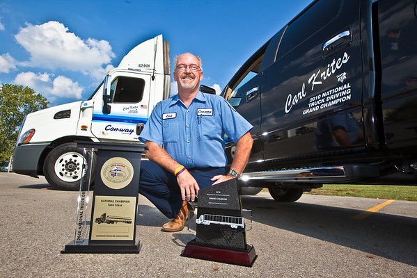 Carl Krites, a Con-way Freight driver sales representative, poses with his awards, his new Cascadia Semi Cab, and his new Ford F150 at the company's Sidney, Ohio service Center Tuesday September 7, 2010 following his crowning as the 2010 National Truck Driving Champion by the American Trucking Associations about a month earlier in Columbus Ohio. (Photo by James D. DeCamp 614-462-8027)