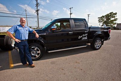 Carl Krites, a Con-way Freight driver sales representative, poses with his new Ford F150 at the company's Sidney, Ohio service Center Tuesday September 7, 2010 following his crowning as the 2010 National Truck Driving Champion by the American Trucking Associations about a month earlier in Columbus Ohio. (Photo by James D. DeCamp 614-462-8027)