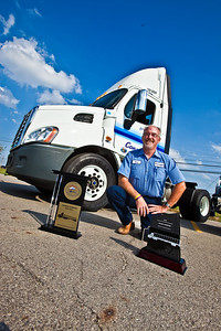 Carl Krites, a Con-way Freight driver sales representative, poses with his awards, his new Cascadia Semi Cab at the company's Sidney, Ohio service Center Tuesday September 7, 2010 following his crowning as the 2010 National Truck Driving Champion by the American Trucking Associations about a month earlier in Columbus Ohio. (Photo by James D. DeCamp 614-462-8027)