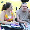 Rehabilitative Resources Inc. held a cook out for its residents t the group home on Rollstone Street in Fitchburg on Saturday.  Paige Billings the director of Development at R.R.I. listens to John Burns during the cookout. SENTINEL & ENTERPRISE/JOHN LOVE
