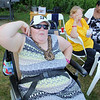 Rehabilitative Resources Inc. held a cook out for its residents t the group home on Rollstone Street in Fitchburg on Saturday.  Having some fun showing off her muscles is Ginger Payne. SENTINEL & ENTERPRISE/JOHN LOVE