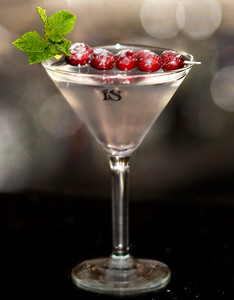 ISopolitan Martini by ISVodka Recipe 1.5 oz ISVodka .5 oz Cointreau 1.5 oz White Cranberry Juice Sugar dusted Cranberry & Spring of Mint for Garnish  Mix ingredients in a shaker with a handful of ice. Pour into a martini glass and enjoy!  Photograph by Mark Bowers Martini prepared by Brady at Via Brasil in Summerlin Las Vegas.
