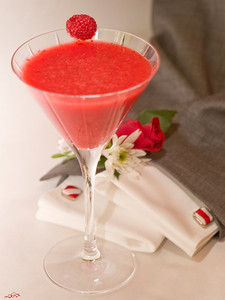 "Best Man - ""Best IS Man"" 1.5 oz. ISVodka  8 Strawberries 1 Fresh Raspberry  Combine ISVodka and sliced strawberries in a blender and puree. Pour into a martini glass. Garnish the glass with a fresh raspberry.    Photograph by Mark Bowers. Set-up and props by Kiki Kalor."