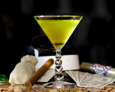 "Father of the Bride - ""Big Spender IS"" or ""Daddy IS"" 1.5 oz ISVodka  1.5 oz. Dry Vermouth Splash of Midori  Combine ISVodka and dry vermouth in a shaker with ice. Shake well and pour in a martini glass. Add a splash of Midori. Big Spenders like it green, the color of money. (Recipe by Chris Campagno)   Photograph by Mark Bowers. Set-up and props by Kiki Kalor. Mixology by Chris Campagno."
