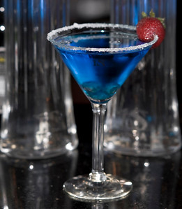 Download high quality free photograph of IS Blue Lagoon the new vodka martini from ISVodka made with 1.5 oz of ISVodka, 1 oz Blueberry Schnapps, .5 oz Blue Curacao and 3 blueberries and 1 strawberry for garnish. Add ISVodka, Blueberry Schnapps and Blue Curacao to ice-filled shaker... shake well. Rim a martini glass with sugar, then pour. Add blueberries and strawberry. Photograph by Mark Bowers.