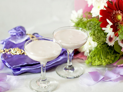 "Mother of the Bride - ""IS Purple Passion"" 1.5 oz ISVodka 1 oz. Chambord Cream  Whipped Cream Topping 1 Fresh Blueberry   Combine ISVodka and Chambord in a shaker with ice. Fill the rest of the shaker with cream. Shake well and pour into a martini glass. Add a dab of whipped cream and garnish with a blueberry on top. Fattening ""-But, oh well, there's always tomorrow.  (Recipe by Chris Campagno)  Photograph by Mark Bowers. Set-up and props by Kiki Kalor. Mixology by Chris Campagno."