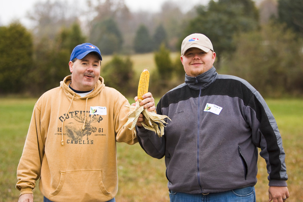 Ah...whew...its the ceremonial cornhole opening...ehr...posing with a corn on the cob...!