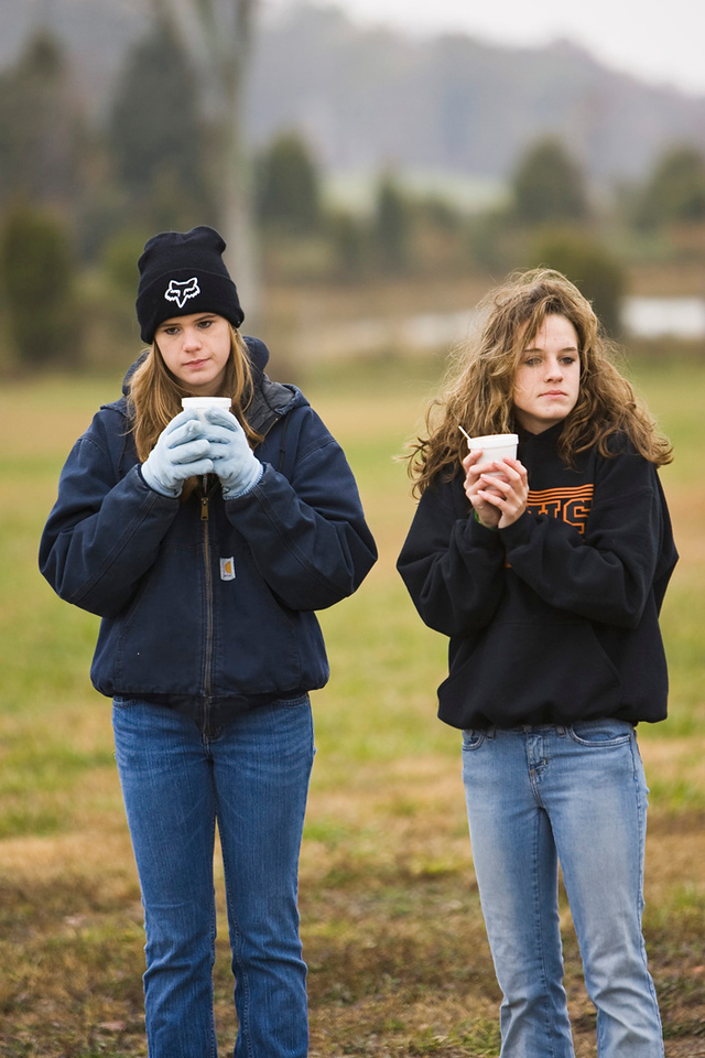 Two of the high school students keeping warm...