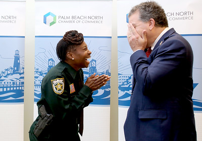 041818 - Riviera Beach -  Palm Beach North Chamber of Commerce breakfast, Wednesday, April 18, 2018 at the  Riviera Beach Marina Village, Event & Conference Center. Jimmy Patronis,  Florida's Chief Financial Officer, State Fire Marshal, and member of the Florida Cabinet, was the keynote speaker. Jimmy Patronis shares a laugh with Deputy Sherry Baker, Palm Beach County Sherriff's Officer prior to the award ceremony Wednesday morning.  Photo by Tim Stepien