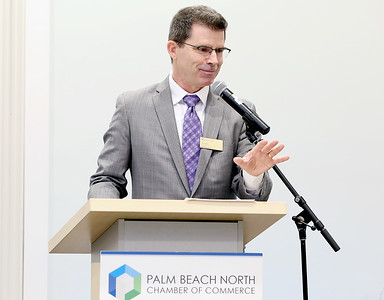 041818 - Riviera Beach -  Palm Beach North Chamber of Commerce breakfast, Wednesday, April 18, 2018 at the  Riviera Beach Marina Village, Event & Conference Center. Jimmy Patronis,  Florida's Chief Financial Officer, State Fire Marshal, and member of the Florida Cabinet, was the keynote speaker. Tim Burke, publisher of The Palm Beach Post speaks during the community service award ceremony  Photo by Tim Stepien