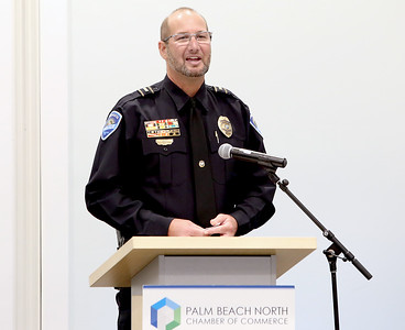041818 - Riviera Beach -  Palm Beach North Chamber of Commerce breakfast, Wednesday, April 18, 2018 at the  Riviera Beach Marina Village, Event & Conference Center. Jimmy Patronis,  Florida's Chief Financial Officer, State Fire Marshal, and member of the Florida Cabinet, was the keynote speaker. Lieutenant James Pike, Tequesta Police Department, accepts his Community Service Award Wednesday morning. Photo by Tim Stepien