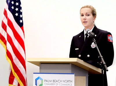 041818 - Riviera Beach -  Palm Beach North Chamber of Commerce breakfast, Wednesday, April 18, 2018 at the  Riviera Beach Marina Village, Event & Conference Center. Jimmy Patronis,  Florida's Chief Financial Officer, State Fire Marshal, and member of the Florida Cabinet, was the keynote speaker. North Palm Beach Fire Rescue Firefighter Amanda Apfel takes the stage to accept her Community Service Award Wednesday morning. Photo by Tim Stepien