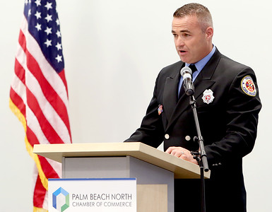 041818 - Riviera Beach -  Palm Beach North Chamber of Commerce breakfast, Wednesday, April 18, 2018 at the  Riviera Beach Marina Village, Event & Conference Center. Jimmy Patronis,  Florida's Chief Financial Officer, State Fire Marshal, and member of the Florida Cabinet, was the keynote speaker. Tequesta Fire Rescue Firefighter David McGovern takes the stage to accept his Community Service Award Wednesday morning. Photo by Tim Stepien
