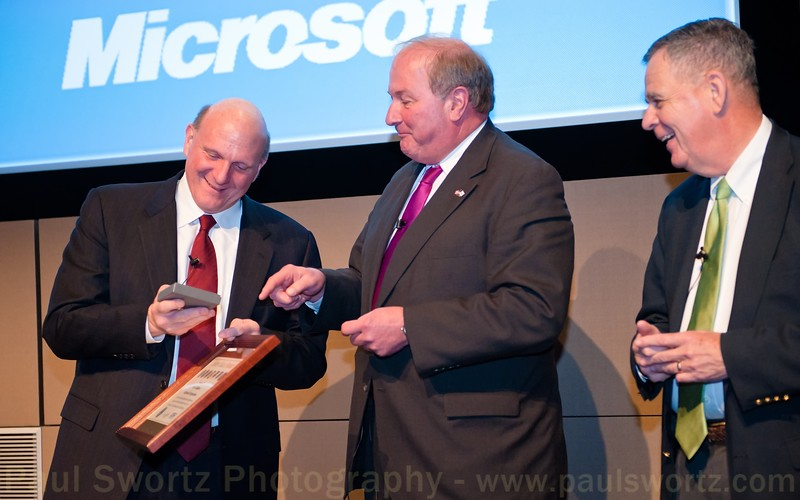Microsoft CEO Steve Ballmer (left) receives a commemorative coaster from James Rebholz (center), national chairman for Employer Support of the Guard and Reserve, and Dennis McCarthy (right), Assistant Secretary of Defense for Reserve Affairs, Wednesday, April 6, 2011, at the company headquarters in Redmond, Wash.