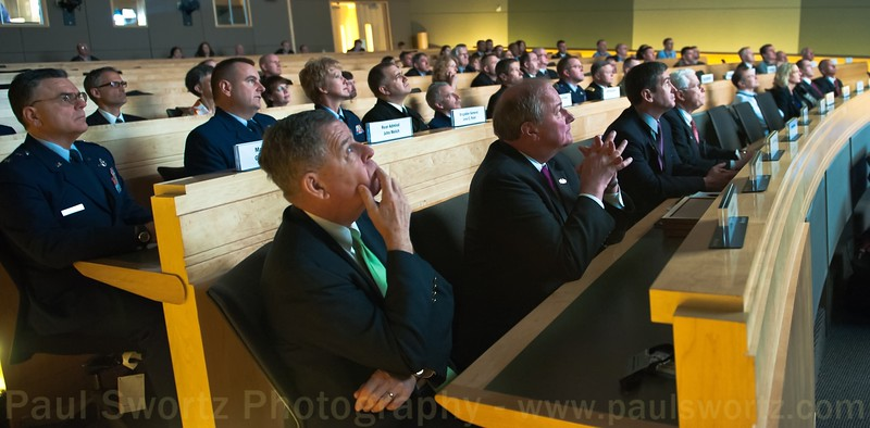 Dennis McCarthy, Assistant Secretary of Defense for Reserve Affairs, and other military personnel, watch a public service announcement describing the mission of the Employer Support of the Guard and Reserve organization, on Wednesday, April 6, 2011, at the company headquarters in Redmond, Wash.
