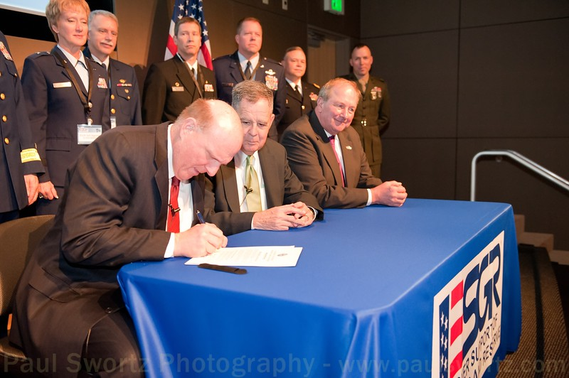 Microsoft CEO Steve Ballmer (left) signs a Statement of Support for the Guard and Reserve with Dennis M. McCarthy (center), Assistant Secretary of Defense for Reserve Affairs, and James Rebholz, national chairman for Employer Supportof the Guard and Reserve, Wednesday, April 6, 2011, at the company headquarters in Redmond, Wash.