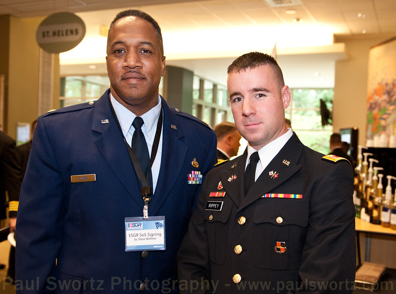 U.S. Air Force Reserve Maj. Stephen Oliver (left) and U.S. Army Reserve 1st Lt. Daniel Rippey are among the citizen soldiers at Microsoft who serve their country while working at the Redmond software company.