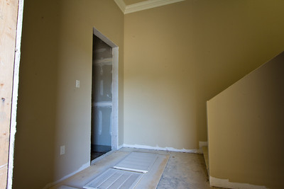 First floor and opening for elevator, as well as stairway leading to rear of condo.