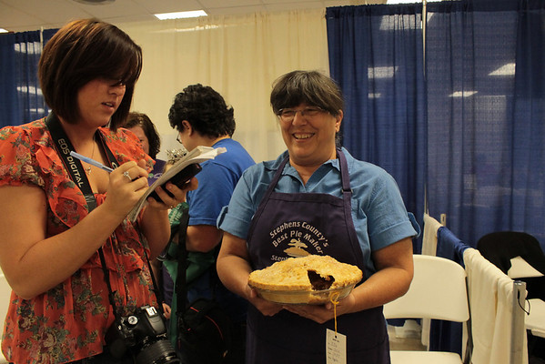 Rebeka Rutledge gets Julie McKinney's reaction for a story, after McKinney was named the best pie baker.