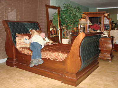 Brother Bob trying out the Sleigh Bed!