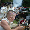 The Nathan Hale Ancient Fifes and Drums Corps fired muskets periodically throughout the parade