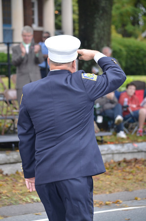 North Coventry Volunteer Fire Department Chief Noel Miller salutes the dignataries at the reviewing stand.