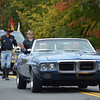 Parade Marshal Al and Julie Bradley in a 1969 Pontiac Firebird.