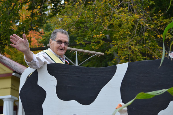 Parade marshal Bob Visny aboard the Coventry Historical Society's float.