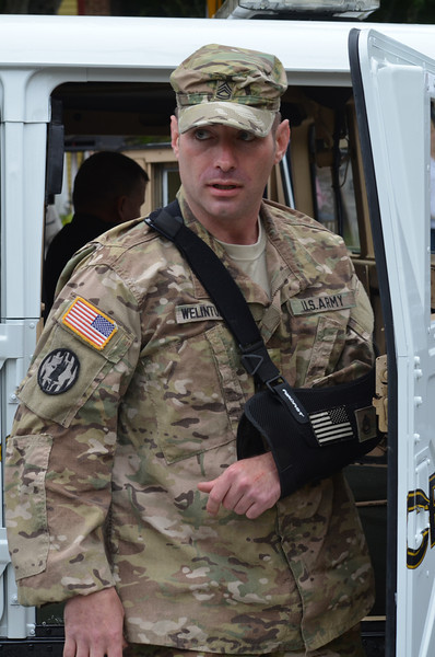 SFC Combat Medic Micah Welintukonis, who was severely injured while on active duty in Afghanistan, rides in the Coventry Police Hummer vehicle on his way to receive the Purple Heart Award at the conclusion of the parade.