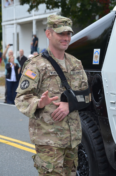 SFC Combat Medic Micah Welintukonis, who was severely injured while on active duty in Afghanistan, on his way to receive the Purple Heart Award at the conclusion of the parade.