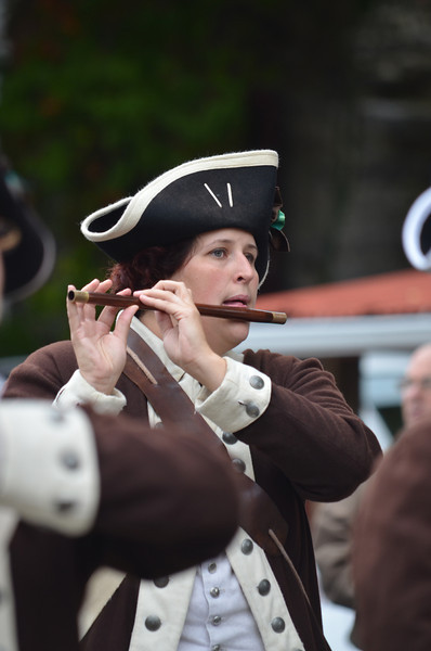 Carla Kennedy, parade committee member, performs with the Nathan Hale Ancient Fifes and Drums Corps.