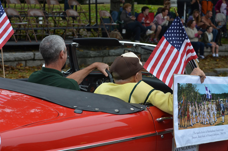 Arnold Carlson, parade marshal, driven in a vintage MG convertible by Town Council member Mike Griswold. Convertible courtesy of John Motycka.
