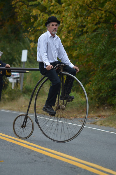 Dudley Brand on an 1880s bicycle.