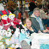 Marilyn Cooper of Coopers Crafts sells dolls and other soft goods with her son.