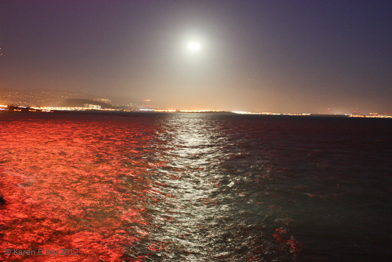 moon over the bay - water is red because a firework just went off