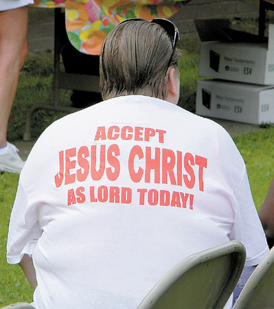 An outreach volunteer wears the message of the day on her back.<br /> — Dan Irwin