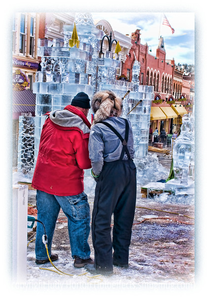Two ice sculptors confer about the ice castle; detail in this image is better viewed in a larger size