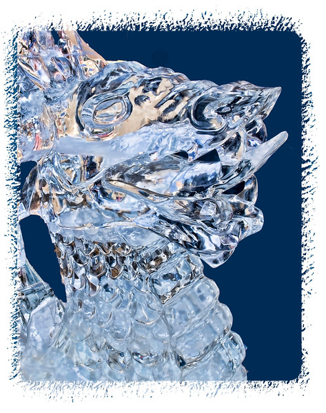 An icy dragon's head at the Ice Festival in Cripple Creek, Colorado; detail of the ice is much better viewed in a larger size.  The background was cut out to emphasize the ice sculpture.