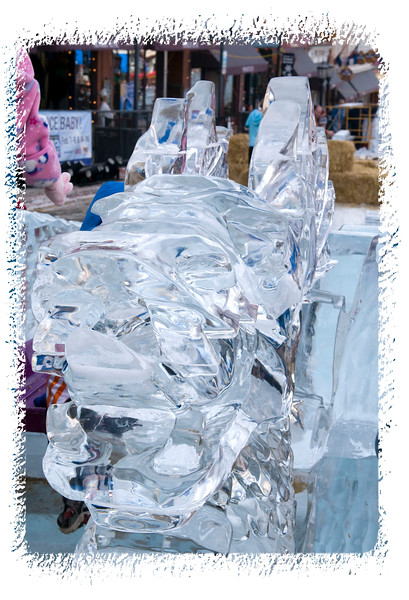 An ice dragon's head, up close; the detail in the ice is much better viewed in a larger size.