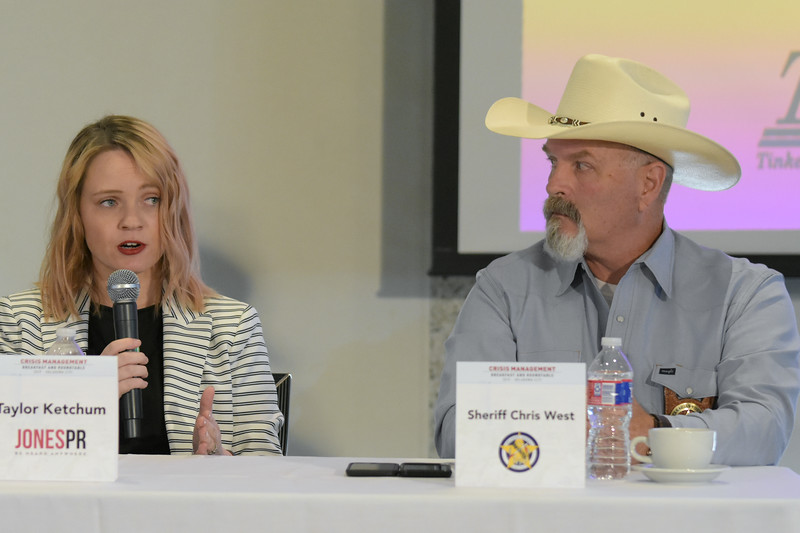 Taylor Ketchum, Jones PR, speaking, with Sheriff Chris West listening, during the first group during the Crisis Management Roundtable event held at the Petroleum Club in Downtown OKC, 8-21-2019.  photo by Mark Hancock
