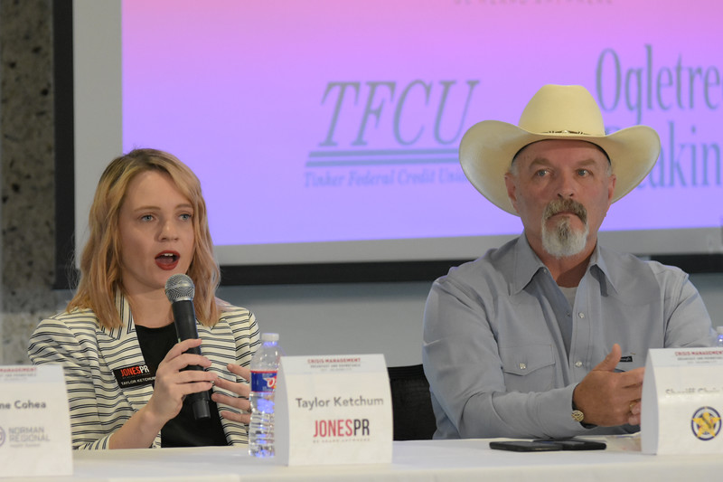 Taylor Ketchum, JonesPR, and Sheriff Chris West, with the first group during the Crisis Management Roundtable event held at the Petroleum Club in Downtown OKC, 8-21-2019.  photo by Mark Hancock