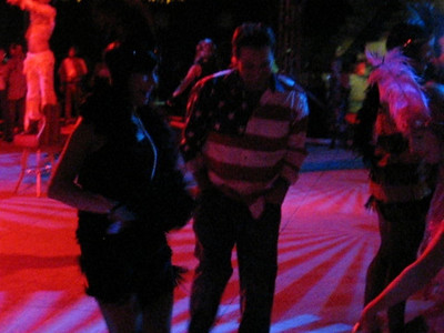 "Video party goers dancing to Nancy Sinatra's ""These Boots Are Made For Walking"" at Criss Angel Gala on Holloween night after his show ""Believe"" held in the pool area of the Luxor where ""Believe,"" a Cirque de Soleil show will run the next 10 years."
