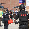 Lowell Police, Fire, UMass Lowell Police, Trinity, LGH and UML EMS, and NEMLEC participate in critical event training at LeLacheur Park involving a simulated attack by gunmen. EMTs move in with protection when it's safe. (SUN/Julia Malakie)