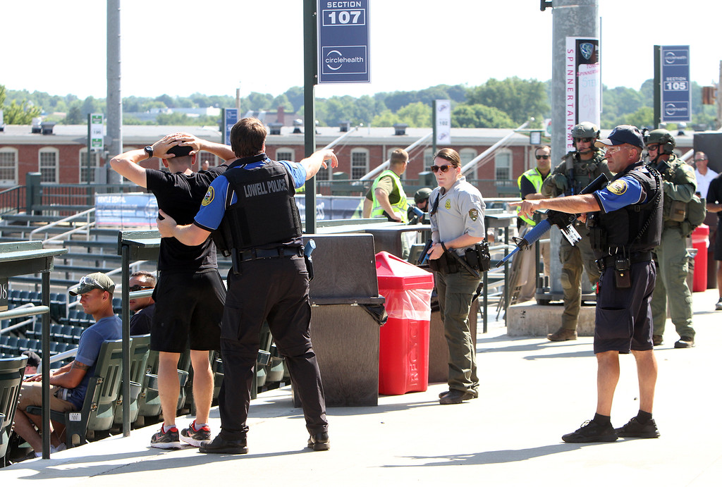 . Lowell Police, Fire, UMass Lowell Police, Trinity, LGH and UML EMS, and NEMLEC participate in critical event training at LeLacheur Park involving a simulated attack by gunmen. Spectators are frisked before being directed to safety. (SUN/Julia Malakie)