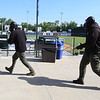 Lowell Police, Fire, UMass Lowell Police, Trinity, LGH and UML EMS, and NEMLEC participate in critical event training at LeLacheur Park involving a simulated attack by gunmen. Bad guys advance. (SUN/Julia Malakie)