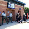 Lowell Police, Fire, UMass Lowell Police, Trinity, LGH and UML EMS, and NEMLEC participate in critical event training at LeLacheur Park involving a simulated attack by gunmen. Victim points the way to bad guys. (SUN/Julia Malakie)