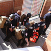 Lowell Police, Fire, UMass Lowell Police, Trinity, LGH and UML EMS, and NEMLEC participate in critical event training at LeLacheur Park involving a simulated attack by gunmen. A victim is carried out on a stretcher. (SUN/Julia Malakie)