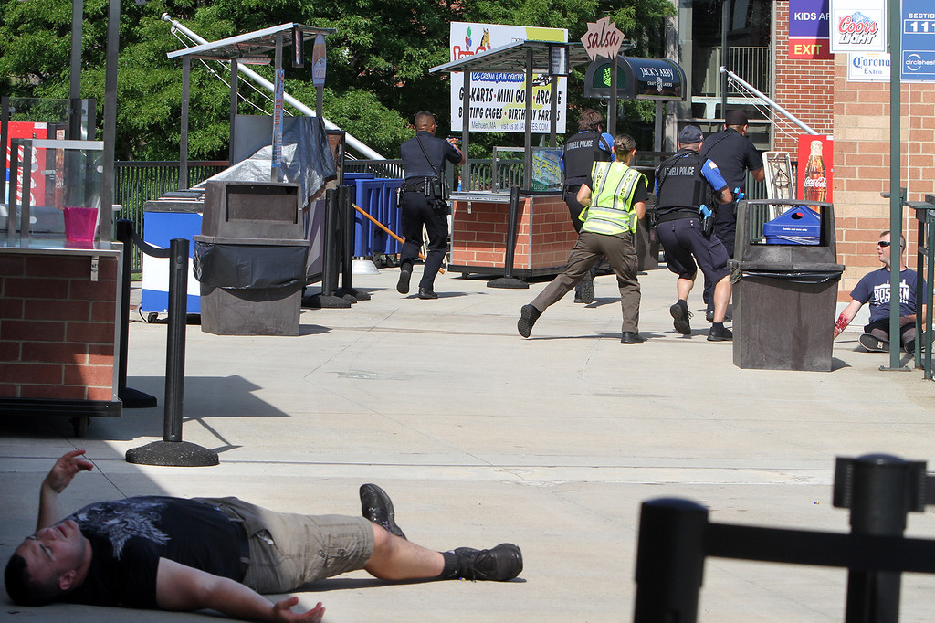 . Lowell Police, Fire, UMass Lowell Police, Trinity, LGH and UML EMS, and NEMLEC participate in critical event training at LeLacheur Park involving a simulated attack by gunmen. (SUN/Julia Malakie)
