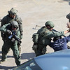 Lowell Police, Fire, UMass Lowell Police, Trinity, LGH and UML EMS, and NEMLEC participate in critical event training at LeLacheur Park involving a simulated attack by gunmen. Officers remove suspect from car. (SUN/Julia Malakie)